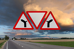 Confusing Unusual Traffic Signs Over Highway with Low Clouds