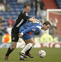 Photo: Aidan Ellis.<br /> Oldham Athletic v Swansea City. Coca Cola League 1. 22/04/2006.<br /> oldham's Mark Hughes holds off swansea's Kevin Mcleod