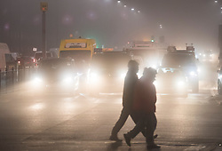 © Licensed to London News Pictures. 19/12/2017. London, UK. Traffic makes it's way through heavy fog on the A40 at Acton in west London as mist and fog hit the capital city. The Met Office has issued weather warnings for freezing fog in parts of the UK, with cancellations expected at Heathrow Airport. Photo credit: Ben Cawthra/LNP