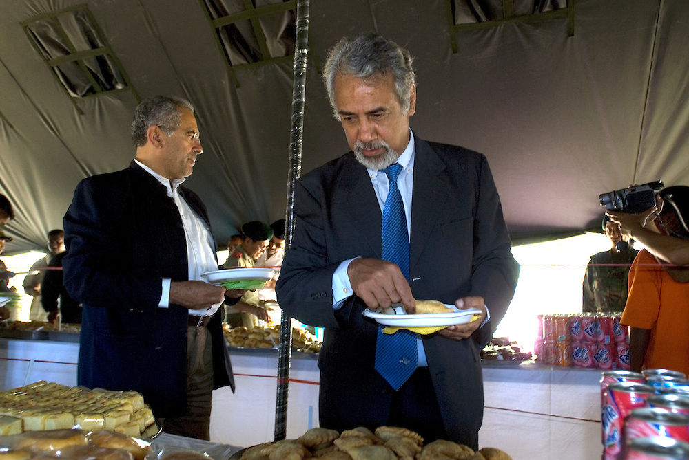 Incoming President Jose Ramos-Horta attends a parade a parade put on for outgoing President Xanana Gusmao by the East Timorese Army. After the Parade they take some time out to enjoy a quick meal.