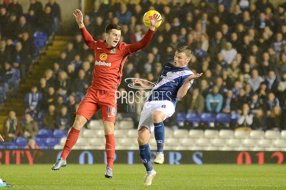 Birmingham City midfielder Stephen Gleeson beats Blackburn Rovers striker Tom Lawrence to a header during the Sky Bet Championship match between Birmingham City and Blackburn Rovers at St Andrews, Birmingham, England on 3 November 2015. Photo by Alan Franklin.