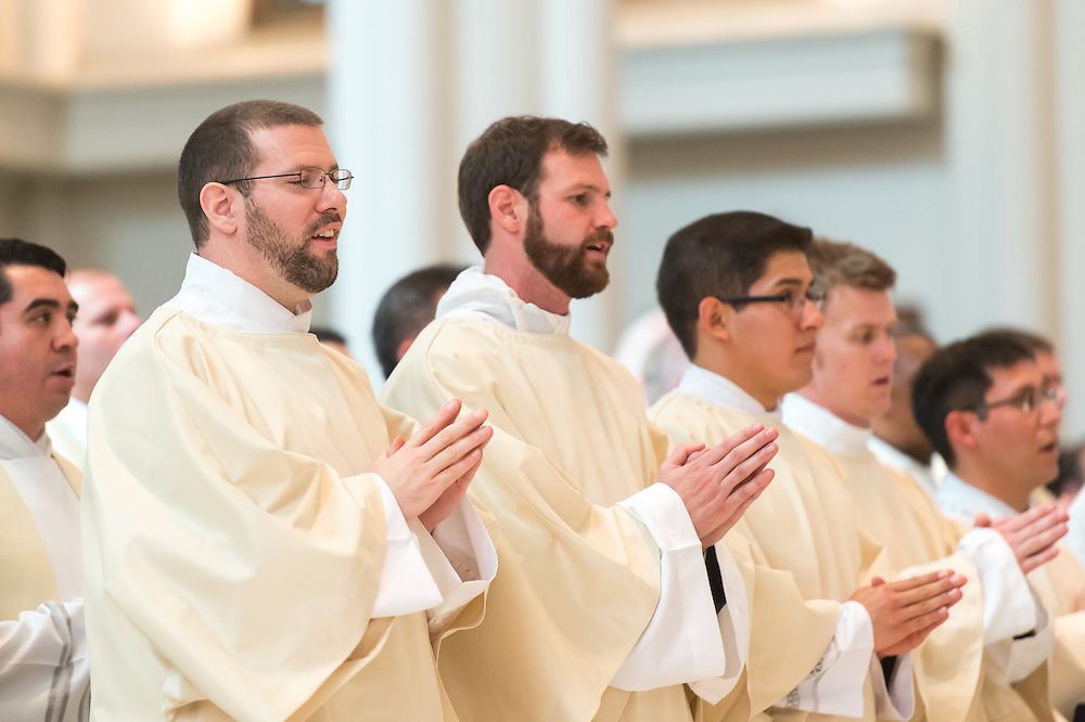 DENVER, CO - MAY 16: From left, the Rev. Gregory Louis Lesher, the Rev. Joseph Marc McLagan, the Rev. Erik Vigil Reyes, the Rev. Tomasz Strzebonski and the Rev. Franklin Anastacio Sequeira Treminio look on during their ordination as priests in the Archdiocese of Denver at the Cathedral Basilica of the Immaculate Conception on May 16, 2015, in Denver, Colorado. (Photo by Daniel Petty/Denver Catholic Register)
