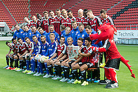 German Soccer Bundesliga 2015/16 - Photocall of FC Ingolstadt 04 on 09 July 2015 in Ingolstadt, Germany: The team of FC Ingolstadt 04 pose with their mascot Schanzi for a commercial.
