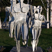 Life size aluminum sculpture by David Govedare titled Ten Feet into the Future, 1986, south end of Elliott Avenue Building, collection of Martin Selig, and adjacent to the new Olympic Sculpture Park, Seattle, WA