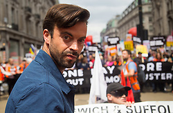 London, July 1st 2017. Anti-Tory protesters march from the BBC's headquarters through the streets of London to Parliament in London following the Conservative Party's £1.5 billion deal with the DUP to enable a slim majority in the House of Commons. PICTURED: The Revolution Will Be Televised's Jolyon Rubenstein