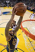 January 31, 2019; Oakland, CA, USA; Golden State Warriors center DeMarcus Cousins (0) dunks the basketball against Philadelphia 76ers guard Landry Shamet (1) during the first half at Oracle Arena.