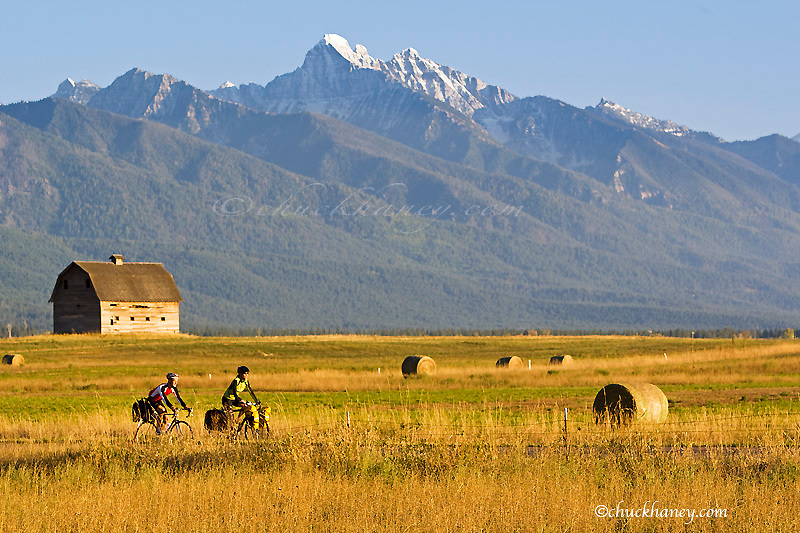 Road bicycle touring down a back country road in the Mission Valley of Montana model released