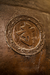 Chinese character carved on a temple's bell, Hanoi, Vietnam, Southeast Asia
