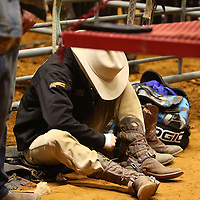 Libby Ezell | BUY AT PHOTOS.DJOURNAL.COM<br /> A Cowboy tightens his boots before the next event at Friday's NE Mississippi Championship Rodeo