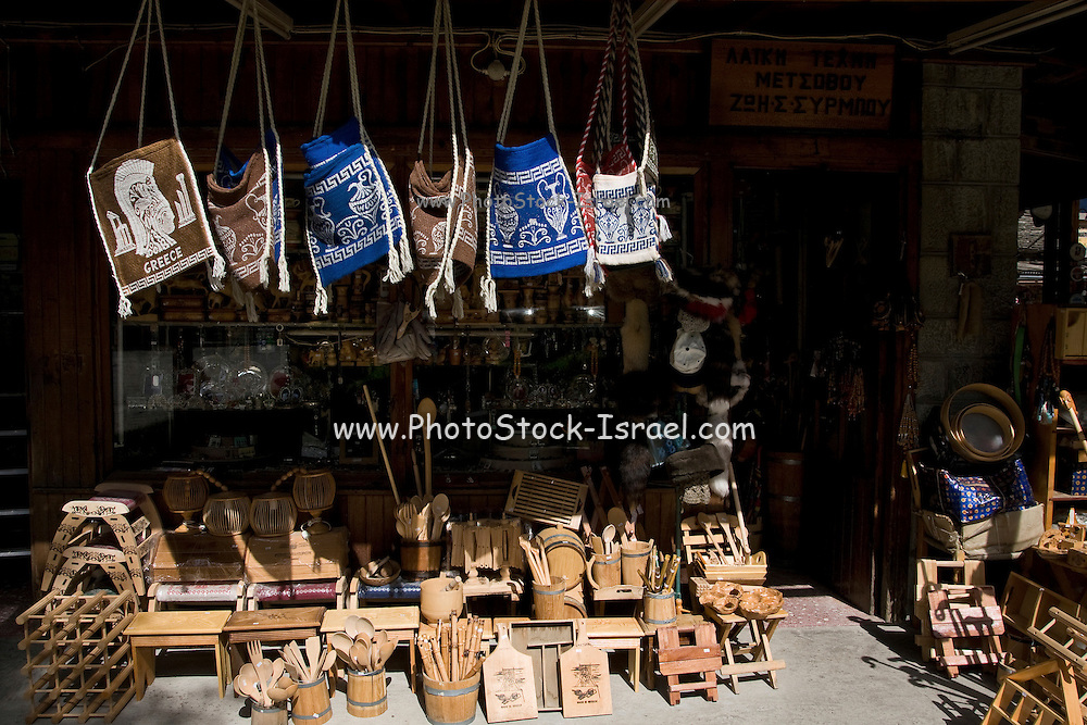 Greece, Epirus, Metsovo, Souvenir shop selling woollen bags and carved wood