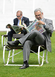 © Licensed to London News Pictures. 01/06/2012. Epsom , UK Men read the Racing Post newspaper before the racing begins. Ladies Day today 1st June 2012 at Epsom 2012 Investic Derby Festival. The Queen will attend tomorrow's race meet as part of the 60th Jubilee celebrations. Photo credit : Stephen Simpson/LNP