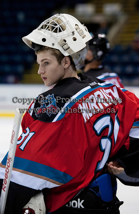 KELOWNA, CANADA - AUGUST 30:  Kelowna Rockets prospect #31, Jake Morrissey stands at the bench during warm up against the Kamloops Blazers on August 30, 2014 during pre-season at Prospera Place in Kelowna, British Columbia, Canada.   (Photo by Marissa Baecker/Shoot the Breeze)  *** Local Caption *** Jake Morrissey;