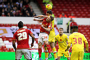 Nottingham Forest midfielder Ben Osborn and MK Dons midfielder Darren Potter challenge for the ball in the air during the Sky Bet Championship match between Nottingham Forest and Milton Keynes Dons at the City Ground, Nottingham, England on 19 December 2015. Photo by Aaron Lupton.