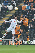 Milton Keynes Dons Alex Revell(18) and Hull City defender Curtis Davies (6)  during the Sky Bet Championship match between Hull City and Milton Keynes Dons at the KC Stadium, Kingston upon Hull, England on 12 March 2016. Photo by Ian Lyall.