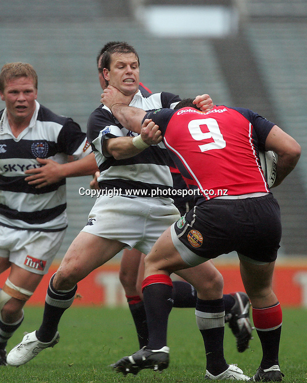 Steve Devine tackles Kahn Fotuali'i during the Air New Zealand Cup rugby union match between Auckland and Tasman at Eden Park, Auckland, New Zealand on Sunday 6 August, 2006. Auckland won the match 46 - 6. Photo: Hannah Johnston/PHOTOSPORT<br /><br /><br /><br /><br />060806