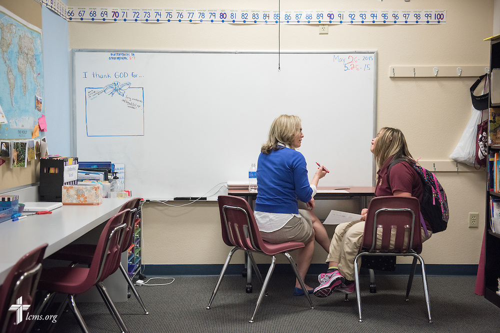 Lee Segalla, director of the Mark 10:14 Program, works with Mark 10:14 Program student Madison Hinskey following class at Faith Lutheran Middle School & High School on Tuesday, May 26, 2015, in Las Vegas, Nev.  LCMS Communications/Erik M. Lunsford