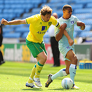 Picture by Alex Broadway/Focus Images Ltd.  07905 628187.30/7/11.Cyrus Christie of Coventry City and Grant Holt of Norwich City during a pre season friendly at The Ricoh Arena, Coventry.