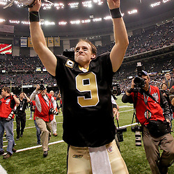 2009 November 30:  New Orleans Saints quarterback Drew Brees (9) celebrates postgame following a 38-17 win by the New Orleans Saints over the New England Patriots at the Louisiana Superdome in New Orleans, Louisiana.