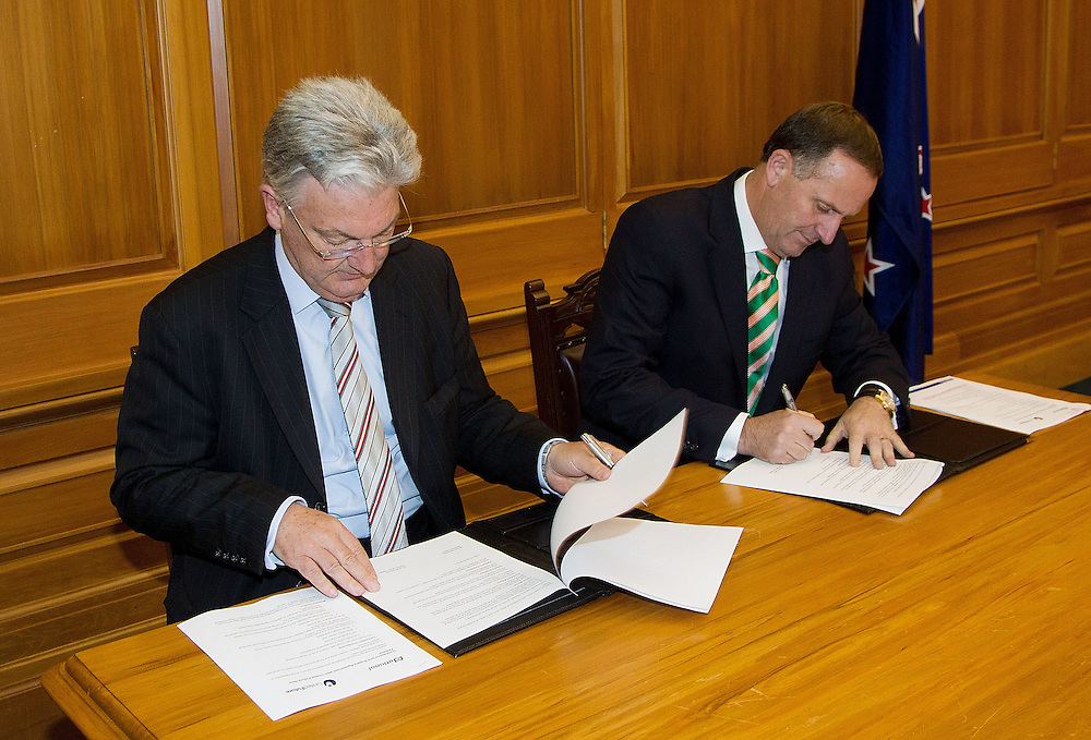 Prime Minister of New Zealand John Key signs a coalition agreement with Peter Dunn (L) leader of the United Future party at Parliament in Wellington, New Zealand, Monday, December 05, 2011. Credit: SNPA / Marty Melville