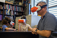 Jeremy Hoch and his two children test a virtual reality kit used for learning activities during Drone Fest at Palmetto Middle School on Saturday, June 2, 2018