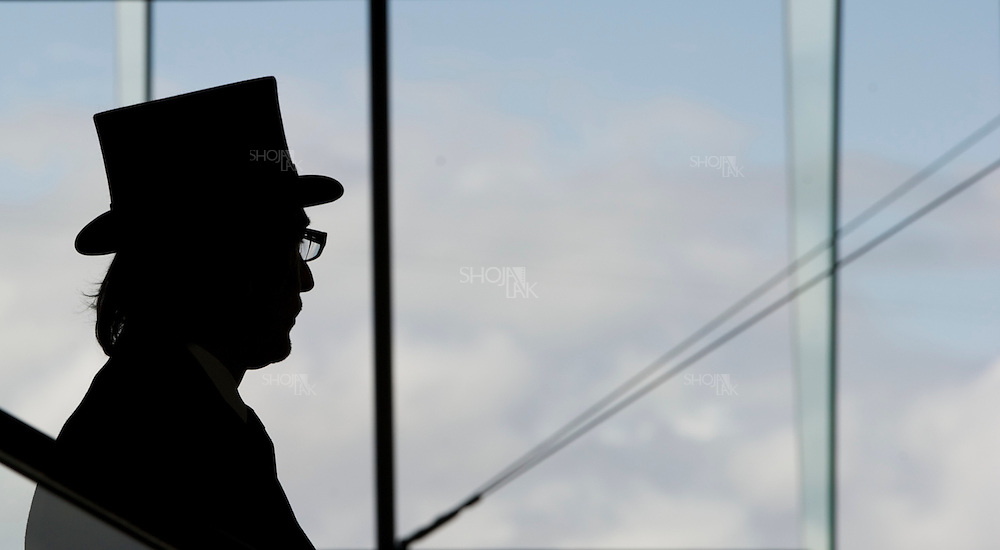 Silhouette of a racegoer on last day of Royal Ascot at Ascot Racecourse on June 18, 2011 in Ascot, England. (Photo by Shoja Lak)