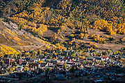 Fall foliage colors in Silverton, Colorado, USA. Silverton is a former silver mining camp, now the federally-designated Silverton Historic District. Durango is linked to Silverton by the Durango and Silverton Narrow Gauge Railroad, a National Historic Landmark. Silverton no longer has active mining, but subsists on tourism, maintenance of US 550 (which links Montrose with Durango), mine pollution remediation, and retirees.