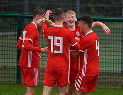 NEWPORT, WALES - Monday, October 14, 2019: Wales' Joshua Thomas (2nd from R) celebrates scoring the second goal with team-mates during an Under-19's International Friendly match between Wales and Austria at Dragon Park. Wales won 2-0. (Pic by David Rawcliffe/Propaganda)