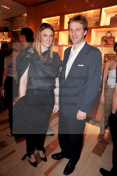 The EARL & COUNTESS OF HARTINGTON at a party to celebrate the opening of the Louis Vuitton Bond Street Maison, New Bond Street, London on 25th May 2010.
