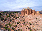 High angle view of the Cathedral Valley area of Capitol Reef National Park, with the Sevier Plateau and Fish Lake National Forest in the background.