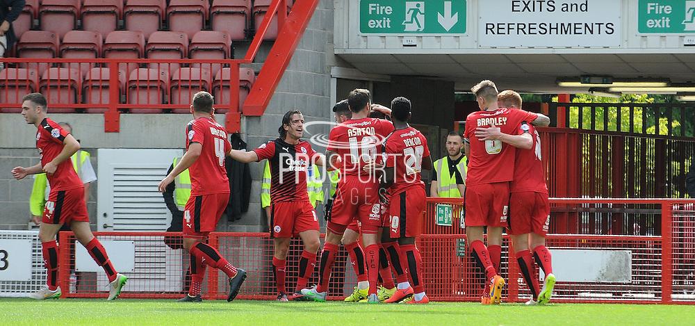 Crawley celebrate their opening goal during the Sky Bet League 2 match between Crawley Town and AFC Wimbledon at the Checkatrade.com Stadium, Crawley, England on 15 August 2015. Photo by Michael Hulf.