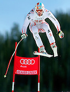 SHOT 12/1/11 12:52:50 PM - Austrian skiier Manuel Kramer launches himself off the Red Tail jump during men's downhill training on the Birds of Prey course at the Audi FIS World Cup on December 1, 2011 in Beaver Creek, Co. (Photo by Marc Piscotty / © 2011)