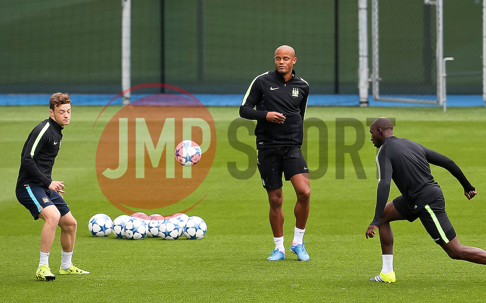 Manchester City captain, Vincent Company, Patrick Roberts and Eliaquim Mangala during the training session at the Etihad Stadium ahead of the UEFA Champions League group D match against Juventus - Mandatory byline: Matt McNulty/JMP - 07966386802 - 14/09/2015 - FOOTBALL - Etihad Stadium -Manchester,England - UEFA Champions League