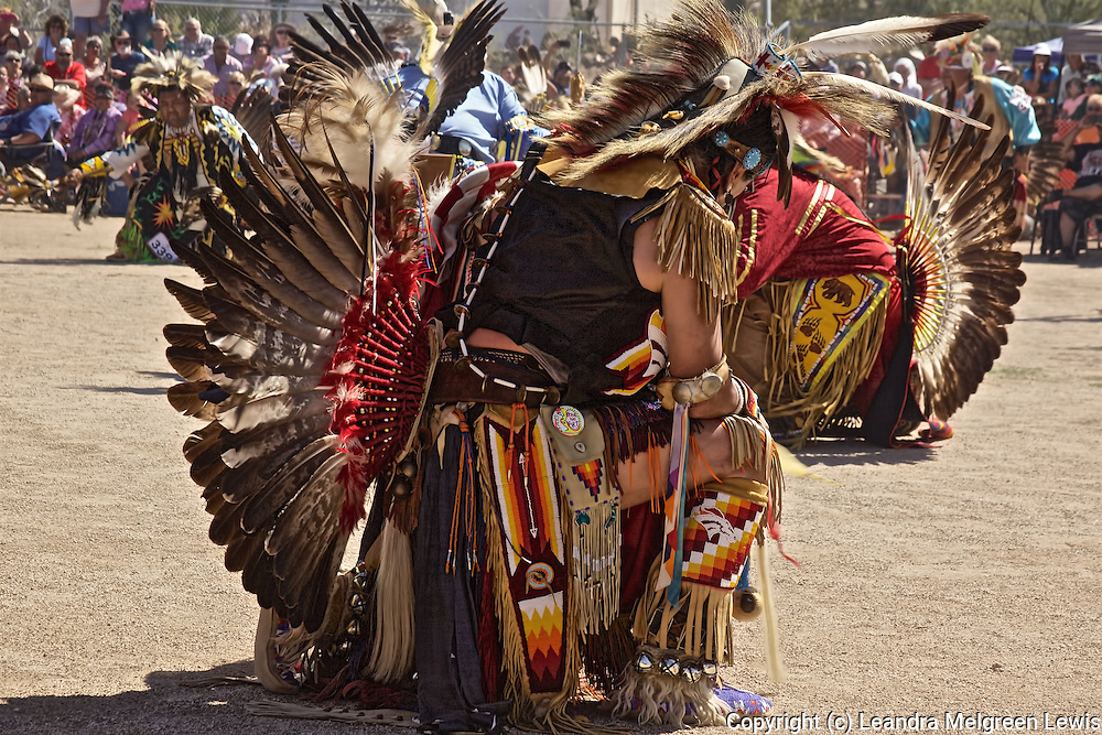 Photo of Pow Wow dancers kneeling at the end of their competitive dance.