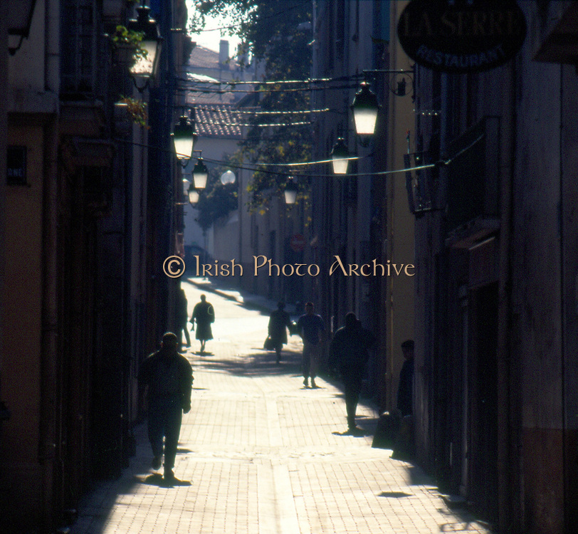 France, Languedoc and Roussillon.  Permignan.  Street in old quarter.