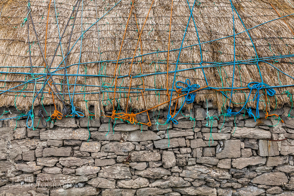 Colorful rope secures a straw roof on Inisheer, one of the Aran Islands of Ireland.