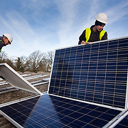 Andy Tyrrell and Jake Beautyman install solar panels on a barn roof on Grange farm, near Balcombe. The installation is part of an initiative by local residents in Balcombe to encourage more people to use renewable energy rather than energy based on carbon such as fracking. The initaitive is called Repowerbalcombe and is supported by the charity 10:10.