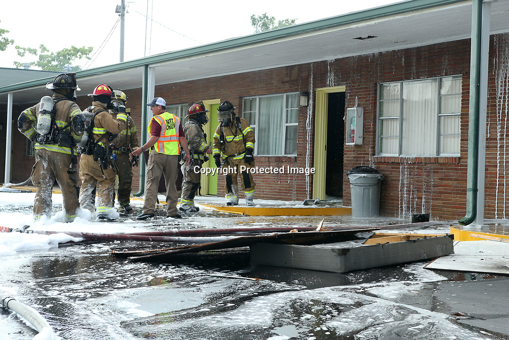 Tupelo firefighters work to put out a fire in a room at the Town House Motel on South Gloster Street Wednesday afternoon in Tupelo.