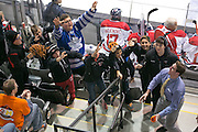 Young fans vie for free t-shirts during a game between the RIT Men's Hockey team and Brock University at the Gene Polisseni Center on Saturday, October 4, 2014.