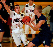 25 FEB. 2011 -- WILDWOOD, Mo. -- Parkway South High School boys' basketball player Ryan McArthy (14) applies defensive pressure to Marquette High School's Zack Ploeger (34) during the MSHSAA Class 5, District 4 boys' championship game at Lafayette High School in Wildwood, Mo. Friday, Feb. 25, 2011. Image (c) copyright 2011 Sid Hastings.