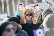 DETROIT - JANUARY 21: Trish White, 48, of Detroit stands with several thousand at the start of a womens march on the campus of Wayne State University Saturday, January 21, 2017 in Detroit. Marches where held all over the state and nation to coincide with the women's march on Washington demanding fairness for all from now President Trump and his administration. (Photo by Bryan Mitchell/Special to Detroit News)