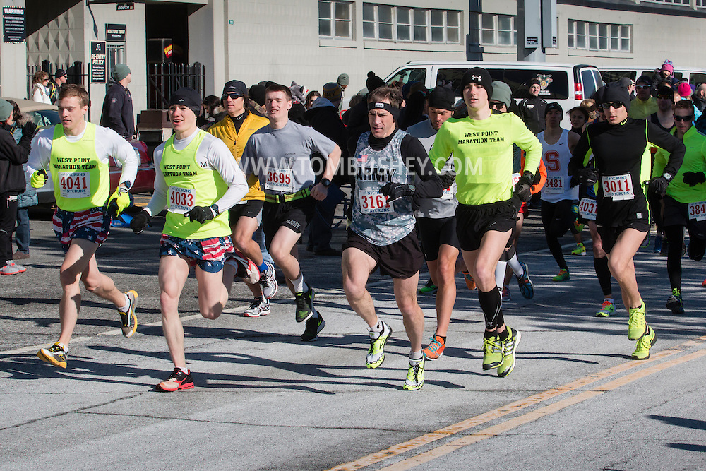 West Point, New York - Runners, including members of the West Point Marathon Team, team off at the start of the West Point Half-Marathon Fallen Comrades Run at the United States Military Academy on March 29, 2015.