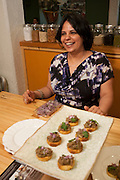 Surbhi Sahni, owner and execitive chef of BiterSeet NYC and pastry chef at Tulsi, with pulled goat leg, garam masala, ginger, green chilis, and cilantro and cashew yogurt pesto.
