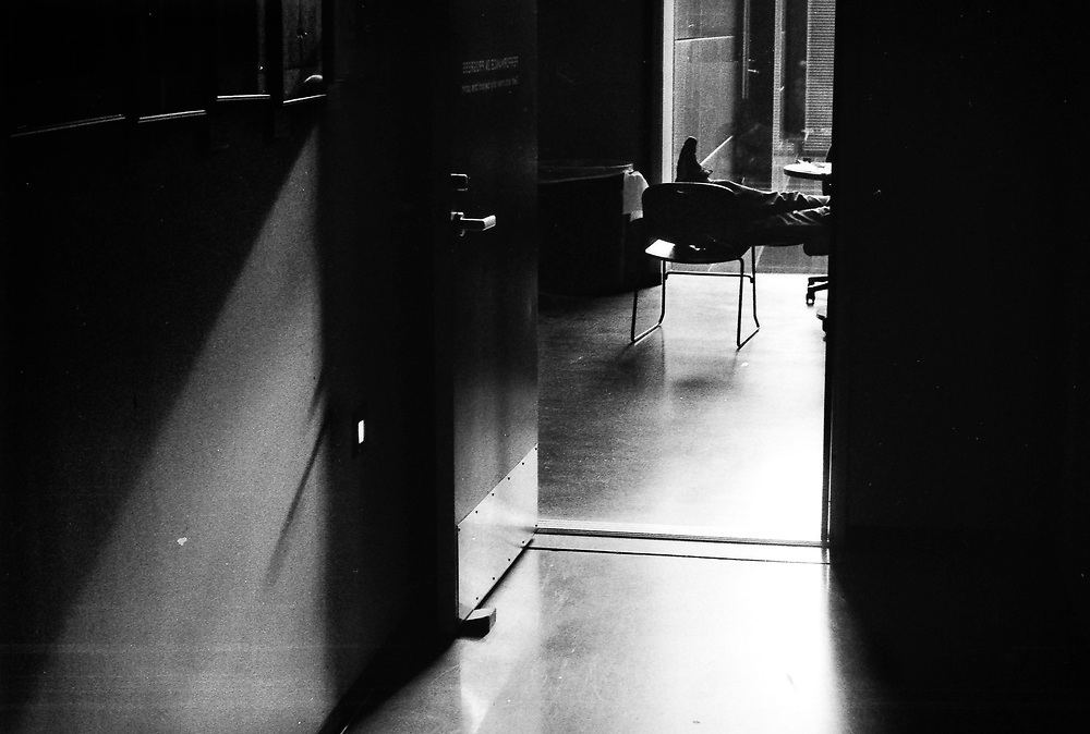 A Guthrie Theater employee kicks their feet back in the production link during a break, May 10, 2013.