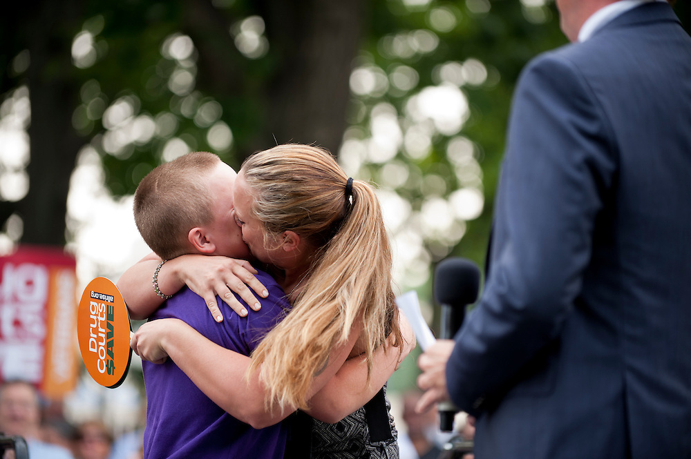MINDY VINCENT kisses her son NICHOLAS VINCENT after his short speach about how Drug Court saved his mother at a rally on Capitol Hill for the National Association of Drug Court Professionals (NADCAP). NADCAP hosted the rally to petition members of Congress to fund drug courts, versus continuing to spend money on the prison system.