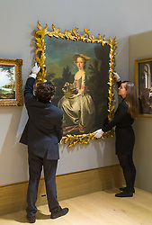 London, July 3rd 2017. Bonhams gallery staff hang Thomas Hudson's Portrait of Albinia Bertie As A Young Girl, Seated in a Landscape holding a Basket of Doves, a Spaniel at Her Feet, which is expected to fetch £60-80,000 in their Old Master Paintings sale.