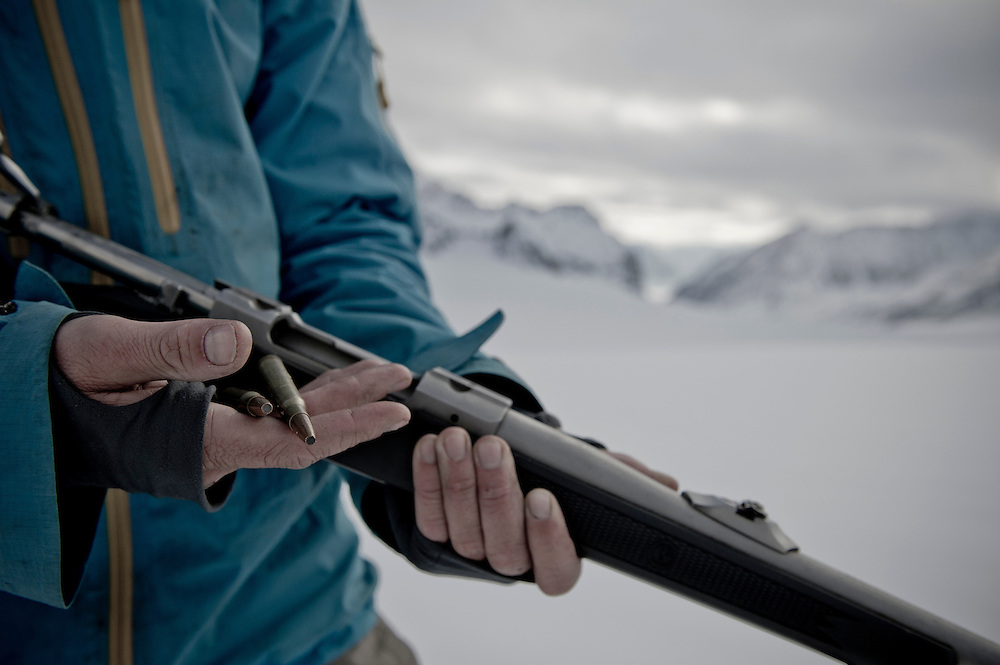 Professional guide Gigi Shimpfossel shows the .33 bullets needed for protection against polar bears during the Further snowboard expedition to Svalbard.