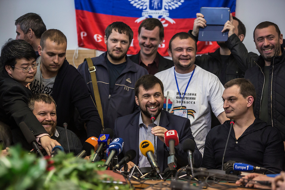 DONETSK, UKRAINE - MAY 8: Denis Pushilin (C), the self-proclaimed chairman of the pro-Russian Donetsk People's Republic, holds a news conference to announce a planned referendum on greater autonomy from the central government in Kiev will go ahead on May 11 as scheduled on May 8, 2014 in Donetsk, Ukraine. Tensions in Eastern Ukraine are high after pro-Russian activists seized control of at least ten cities and ahead of the Victory Day holiday and a planned referendum on greater autonomy for the region. (Photo by Brendan Hoffman/Getty Images) *** Local Caption *** Denis Pushilin