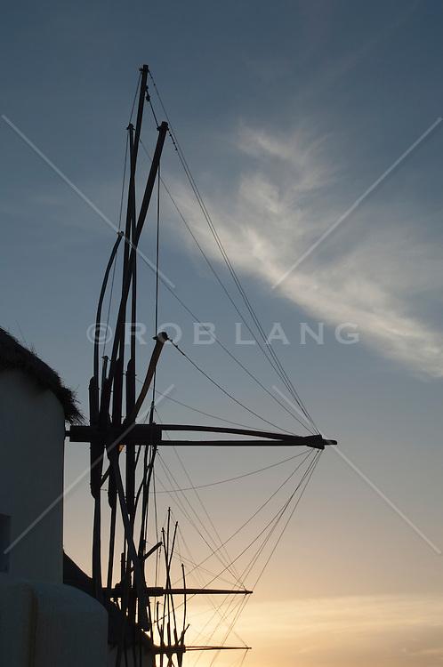 Windmills at sunset in Mykonos, Greece