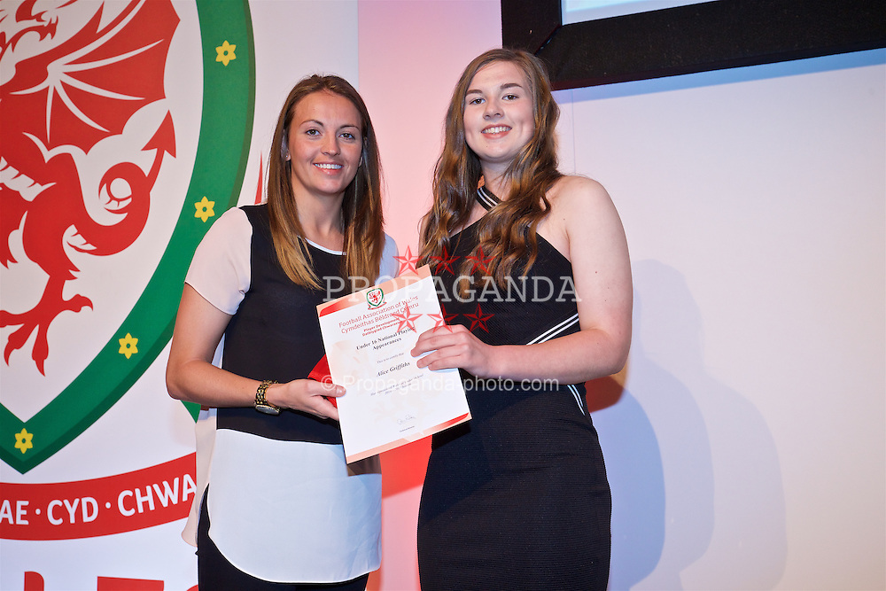 NEWPORT, WALES - Saturday, May 21, 2016: Alice Griffiths is presented with her Under-16's cap by Wales player Kayleigh Green at the Celtic Manor Resort. (Pic by David Rawcliffe/Propaganda)