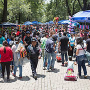 A pedestrian street lined with market stalls in Basque de Chapultepec, a large and popular public park in the center of Mexico City.